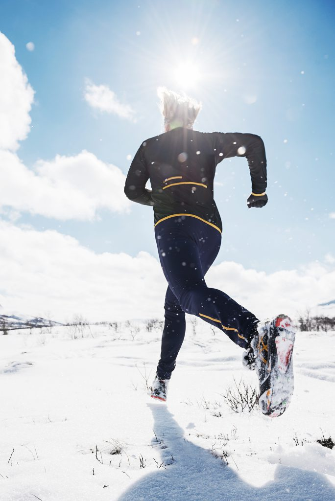 Winter runner on snow in the Swedish mountains