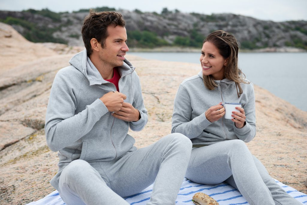Couple in outdoor lifestyle photoshoot by the ocean