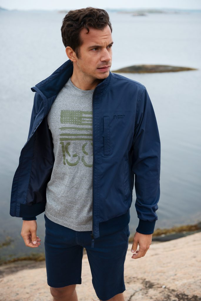 Man in outdoor lifestyle photoshoot by the ocean