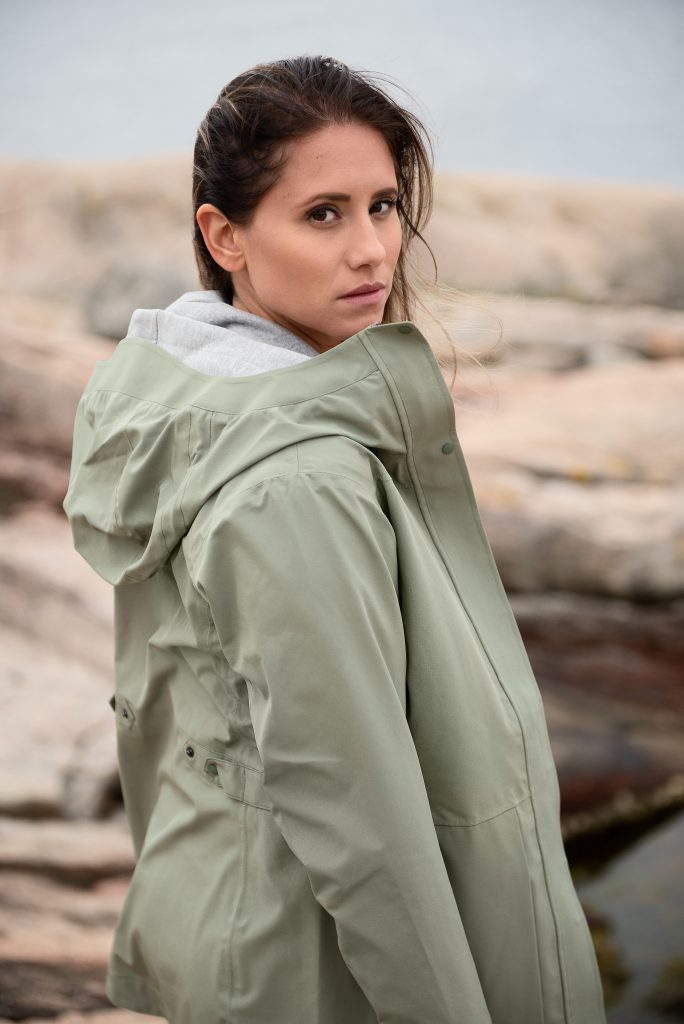 Woman in outdoor lifestyle photoshoot by the ocean