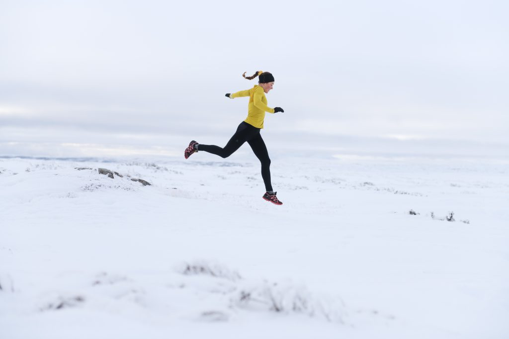 Winter runner in outdoor lifestyle photoshoot