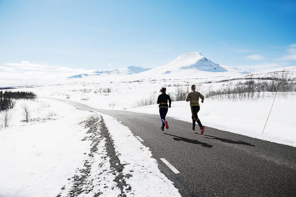 Winter runners on an asphalt road
