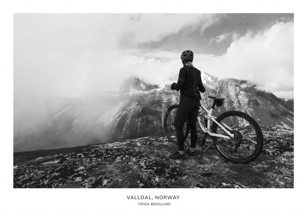 Woman and bicycle on a mountain in Valldal Norway